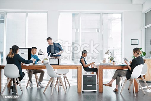 Shot of a team of businesspeople working together in a modern office
