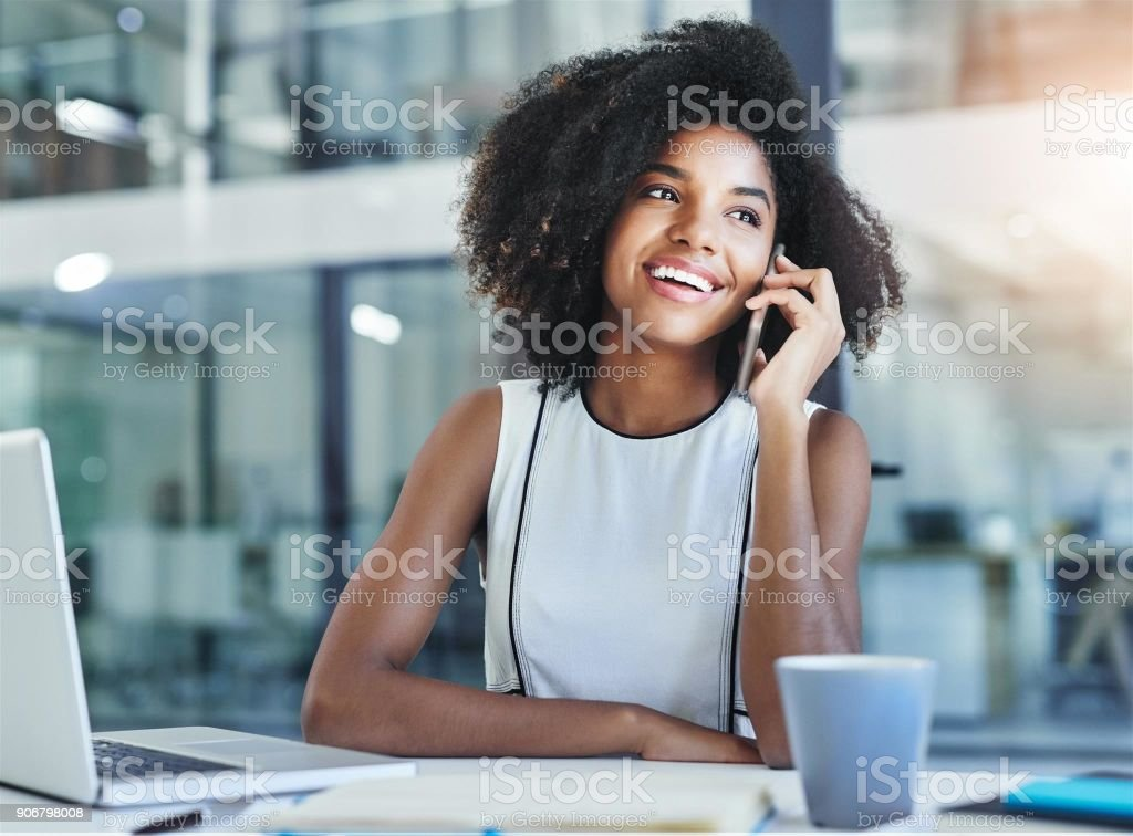 Handling her business one call at a time stock photo