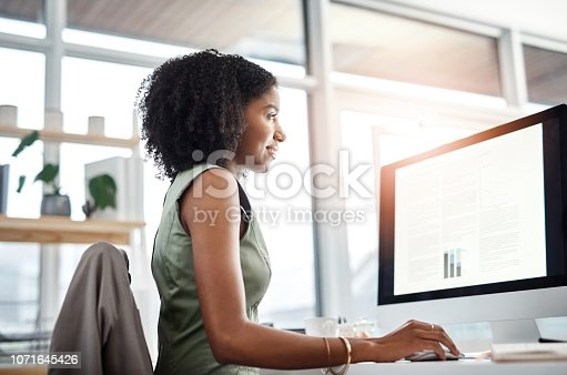 Shot of a young businesswoman working at her desk in a modern office