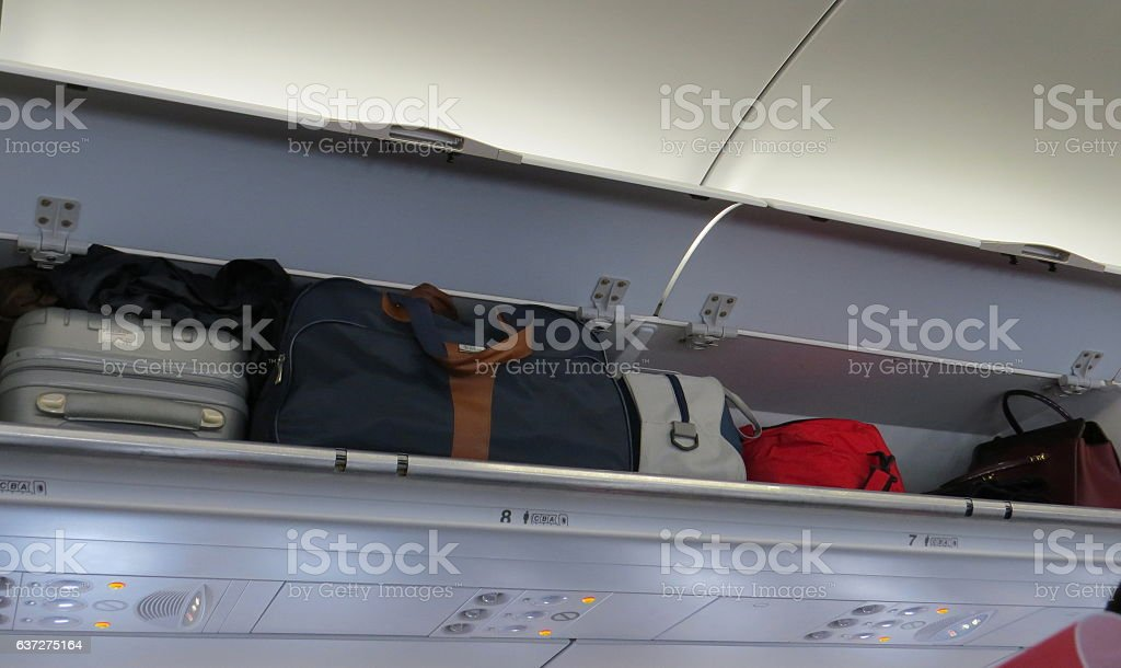 Hand-luggage compartment in an airplane stock photo