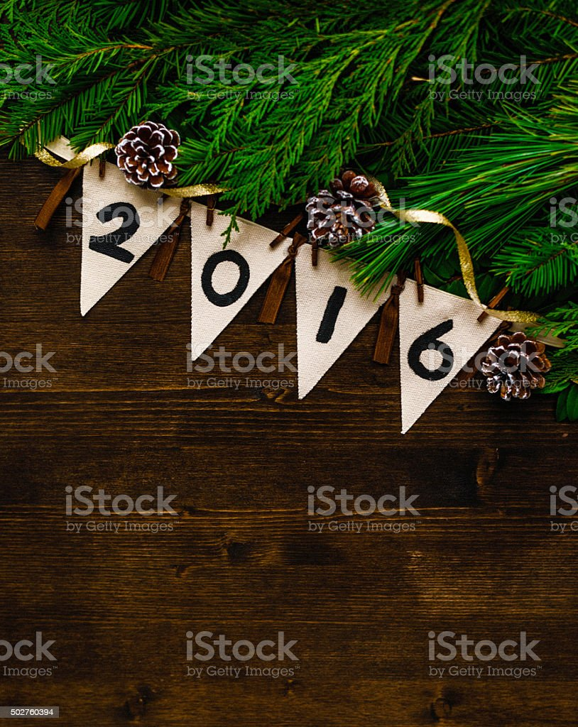 Handmade 2016 banner against wooden background with foliage stock photo