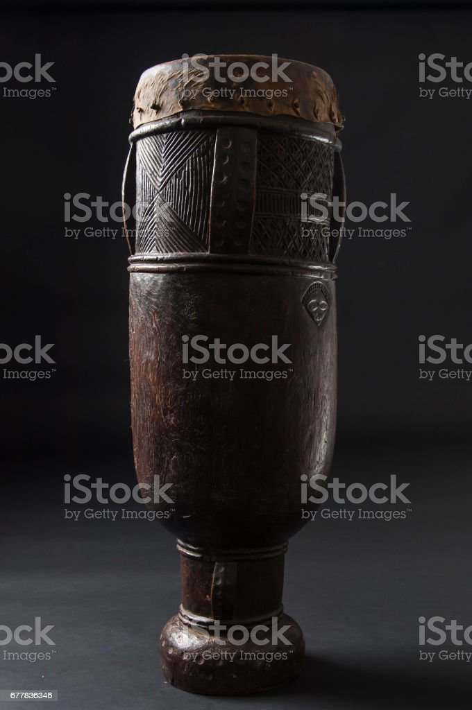 Handmade african instrument, wooden drum, isolated on black background royalty-free stock photo