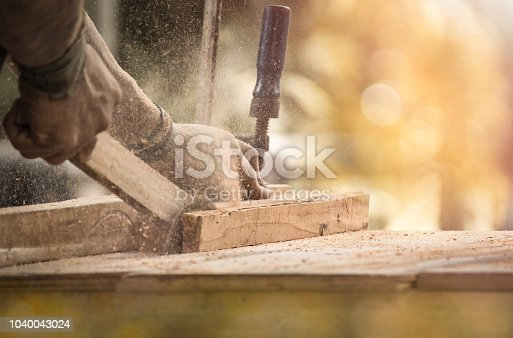 Carpenter engaged in processing wood at the sawmill