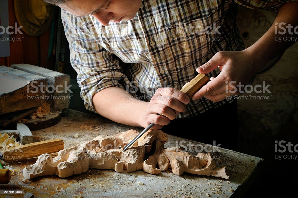handmade art cutting wood carving with cutter stock photo