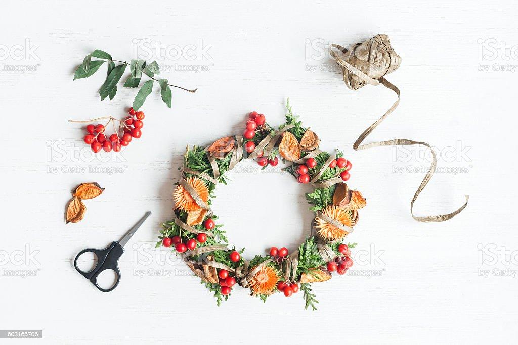 Handmade autumn wreath. Top view, flat lay stock photo