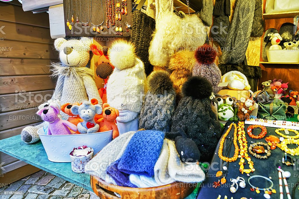 Handmade bears and hats on display at Riga Christmas market stock photo