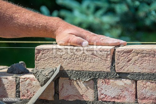 istock handmade brick wall construction build 502025357