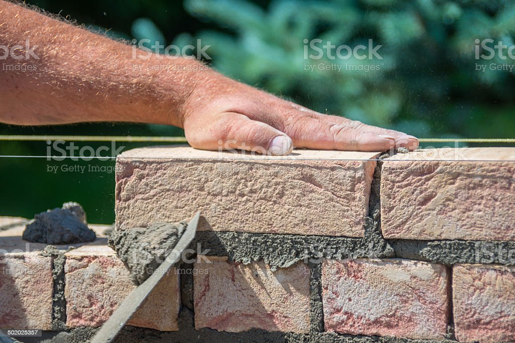 handmade brick wall construction build stock photo
