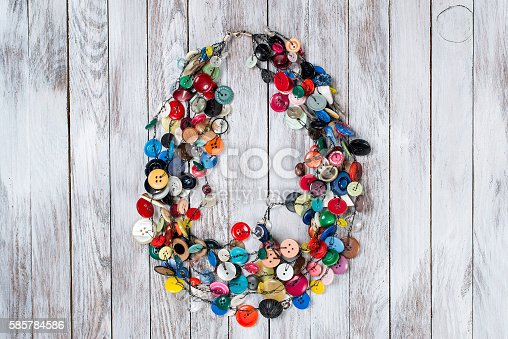istock Handmade bright colored jewelry made of plastic buttons. 585784586