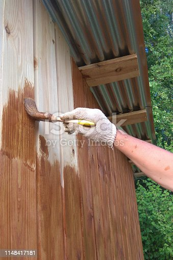 istock Handmade brush for manual painting on a wooden wall 1148417181