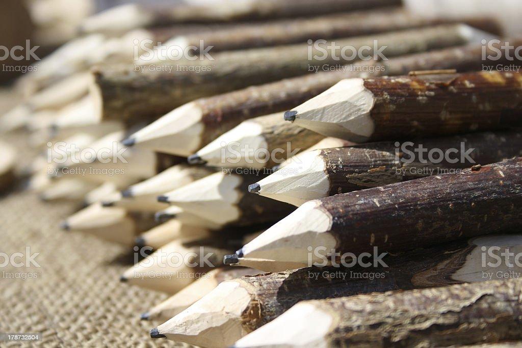 Handmade carved pencils stock photo