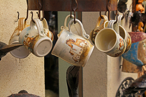Handmade ceramic mugs on street market in Besalu
