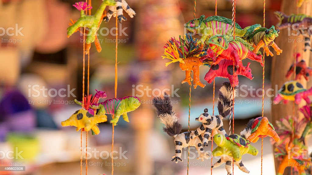 Handmade chameleons and lemur puppy toys stock photo
