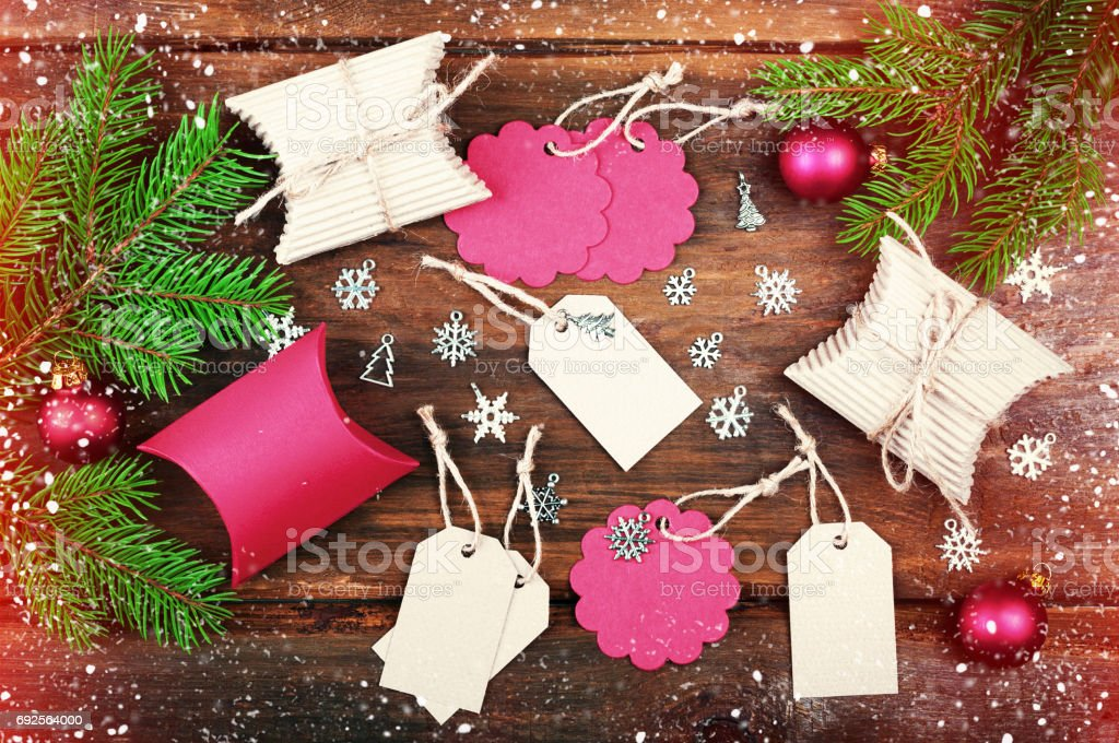 Christmas Gift Tags Handmade.Handmade Christmas Gift Tags And Christmas Gift Boxes On Wooden Table Background Christmas Tree Branch Snowflakes And Ornaments Balls Top View Toning
