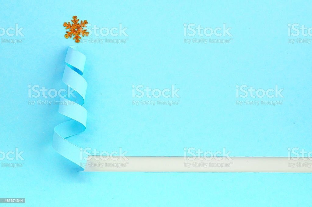 Handmade Christmas tree cut out from blue paper. stock photo