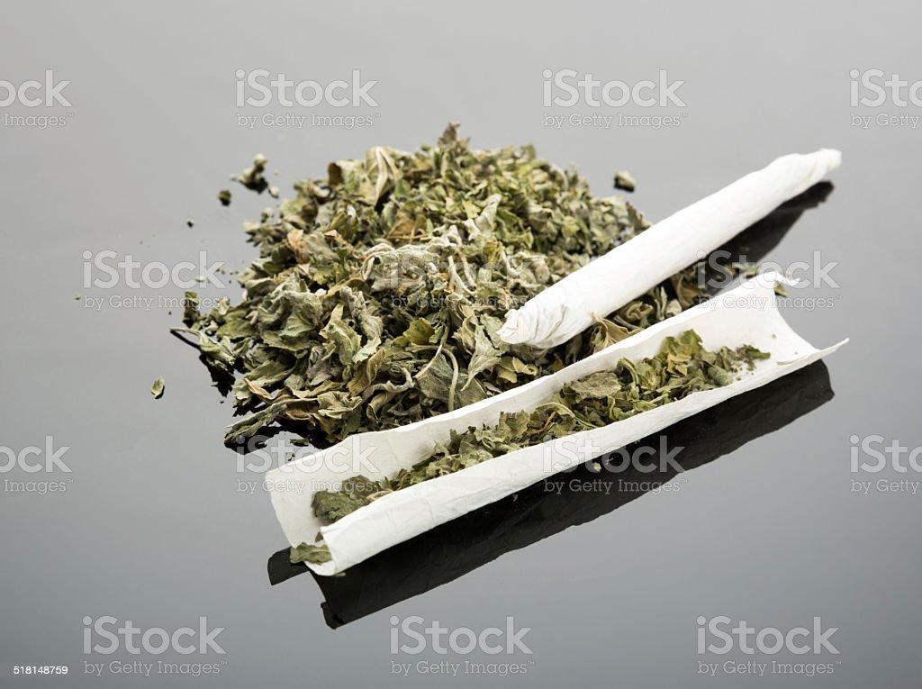 Handmade cigarette on gray background stock photo