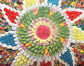 Handmade circular rug with floral pattern in patchwork style