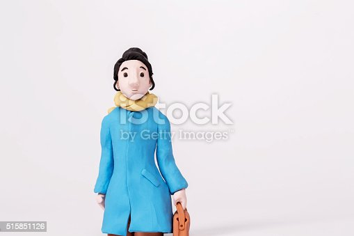 handmade clay figurine: girl walking on the way
