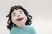 handmade clay figurine: laughing girl