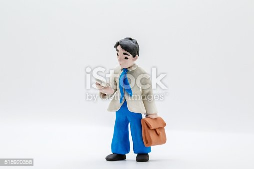handmade clay figurine: office man reading mobile phone on the way