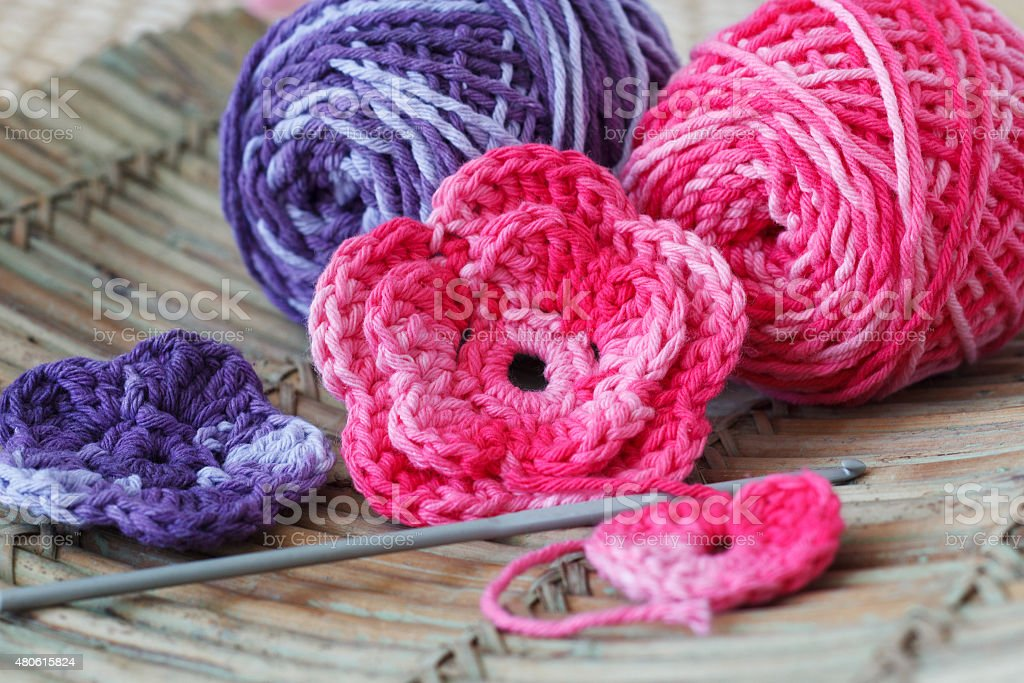 Handmade colorful crochet flowers with skein stock photo