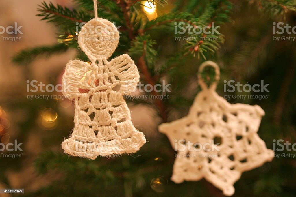handmade crochet angel and star ornaments on the christmas tree royalty free stock photo - Crochet Angel Christmas Tree Decorations