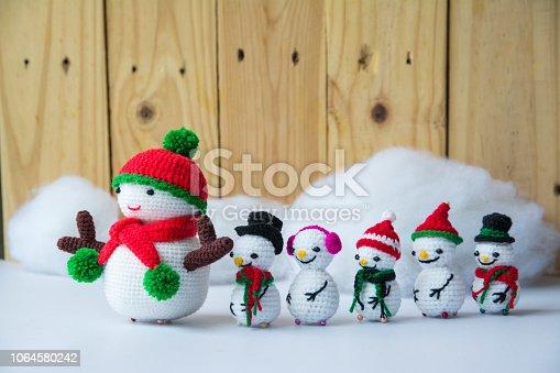 istock Handmade crochet  knitting snowman dolls for Christmas Concept 1064580242