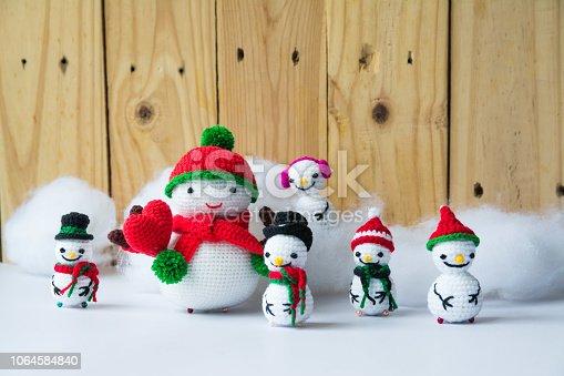 istock Handmade crochet  knitting snowman dolls for Christmas Concept 1064584840