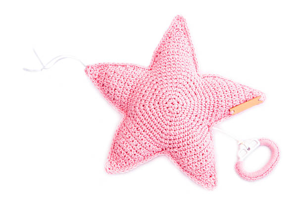 Handmade Crochet Pink Star Shape Music Box Isolated On White stock photo