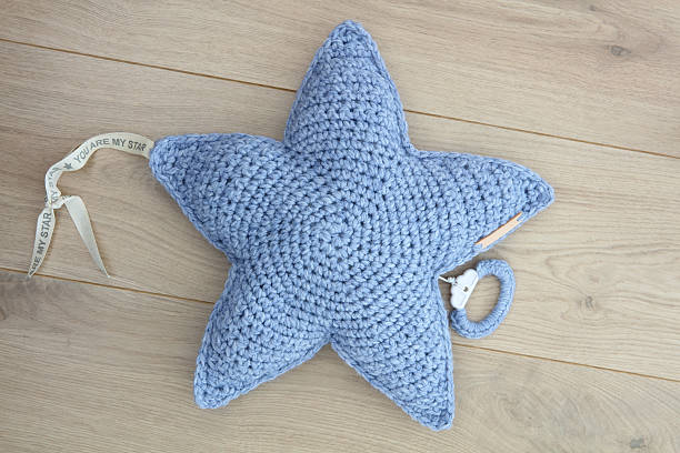 Handmade Crochet Star Shape Music Box stock photo