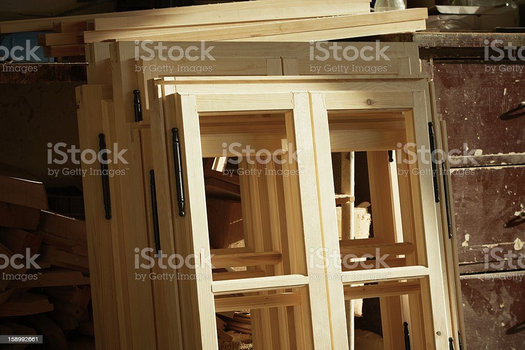 Handmade custom wooden window frames stacked together  stock photo