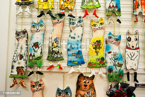 Hand-made decorative cats from colored glass in a shop window of Estonia in the old tourist center of Tallinn
