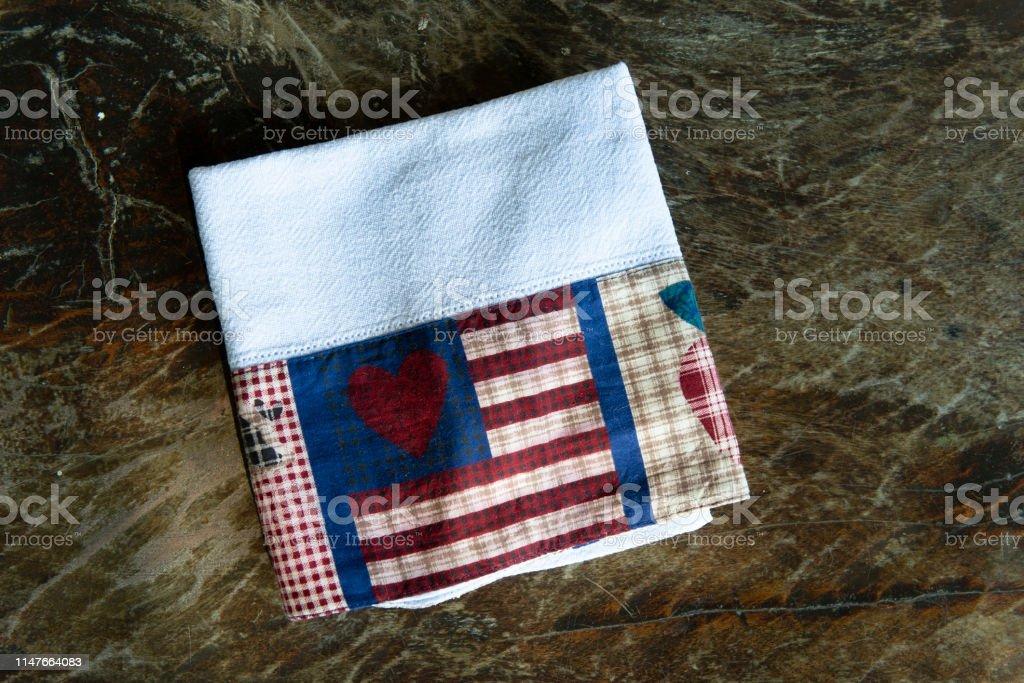 handmade dish cloth on a dark wood background