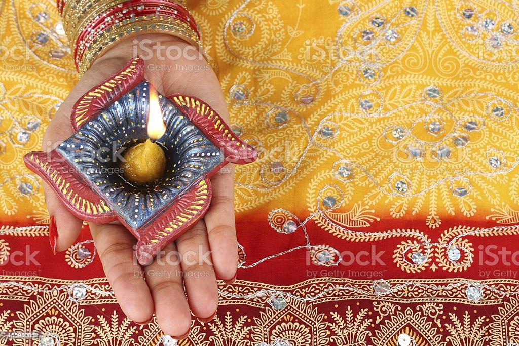Handmade Diwali Diya Lamp in Hand stock photo