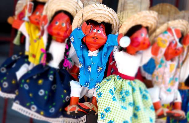 Handmade dolls at market stock photo