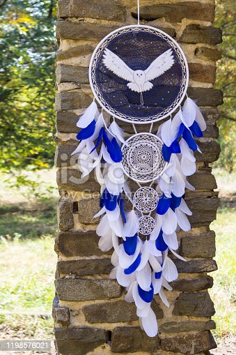 istock Handmade dream catcher with feathers threads and beads rope hanging 1198576021