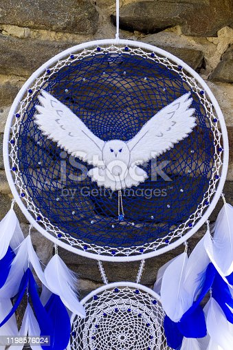 istock Handmade dream catcher with feathers threads and beads rope hanging 1198576024