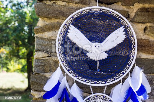 istock Handmade dream catcher with feathers threads and beads rope hanging 1198576025