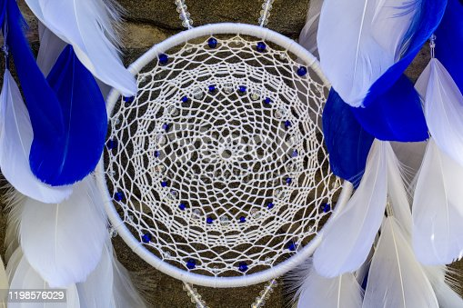istock Handmade dream catcher with feathers threads and beads rope hanging 1198576029