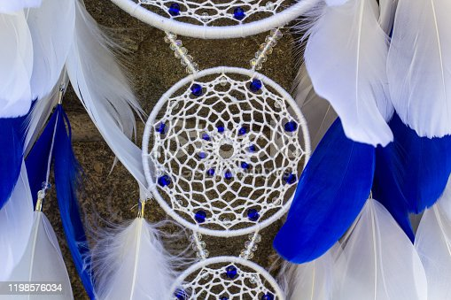 istock Handmade dream catcher with feathers threads and beads rope hanging 1198576034