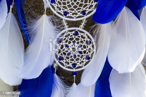 istock Handmade dream catcher with feathers threads and beads rope hanging 1198576035