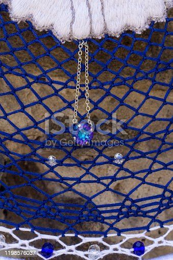 istock Handmade dream catcher with feathers threads and beads rope hanging 1198576037
