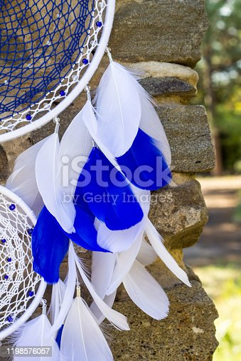 istock Handmade dream catcher with feathers threads and beads rope hanging 1198576057