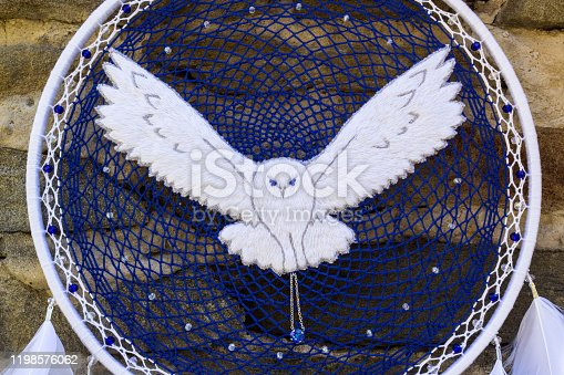 istock Handmade dream catcher with feathers threads and beads rope hanging 1198576062