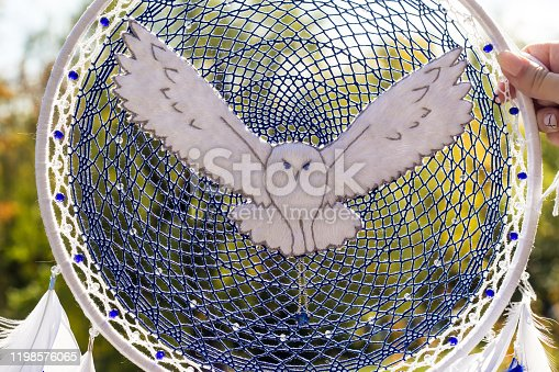 istock Handmade dream catcher with feathers threads and beads rope hanging 1198576065