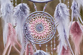 istock Handmade dream catcher with feathers threads and beads rope hanging 1199719285