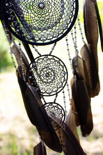 Handmade dream catcher with feathers threads and beads rope hanging Dream catcher with feathers threads and beads rope hanging. Dreamcatcher handmade carving craft activity stock pictures, royalty-free photos & images