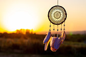 istock Handmade dream catcher with feathers threads and beads rope hanging 1271067249