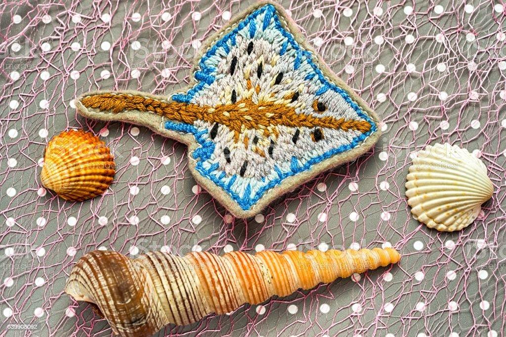 handmade embroidered ramp fish stock photo