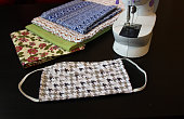 face mask and pieces of fabric sewing items and sewing machine
